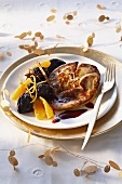 Fried goose liver with prunes and oranges