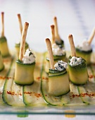 Courgette rolls filled with cream cheese and bread sticks