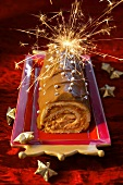 A yule log decorated with sparklers