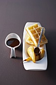 Waffles with pears and chocolate sauce