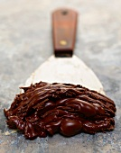 Chocolate Frosting on a Wide Metal Spatula