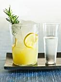 Glass of Lemonade with Rosemary; Shot Glass