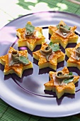 Polenta stars topped with anchovies
