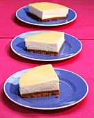 Slices of cheese cake on three plates