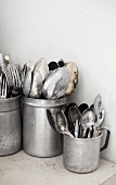 Old cutlery in aluminium cups