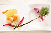 Scallops with potato chip, chilli and pitahaya (China)