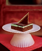 A Chocolate Mint Bar on a Small White Pedestal Dish