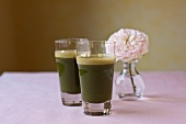Green Juice made from Spinach, Kale, Carrots, Celery, Strawberries, Apple and Kombucha