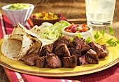 Carne Asada; Mexican Grilled Beef with Tortillas; Assorted Toppings