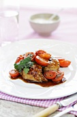 Chicken legs with marinated tomatoes and tzatziki