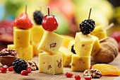 Cheese on sticks with fruit and nuts