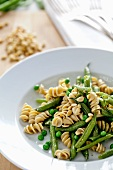 Pasta with Green Beans, Peas and Pine Nuts; In a White Bowl