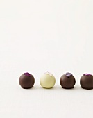 Four Assorted Chocolate Truffles with Candied Flower Petal Garnishes