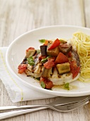 Grilled Chicken Topped with Eggplant Ragu and Served with Pasta