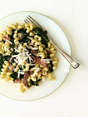 Corkscrew Pasta with Ham and Spinach on a Plate; From Above