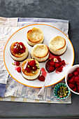 Miniature goat's cheese and pistachio cheesecakes with raspberries and rosewater