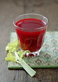 A glass of carrot and beetroot juice with celery