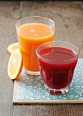 Carrot and orange juice and beetroot and apple juice