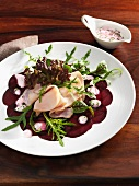 Beetroot carpaccio with ham and herb sauce