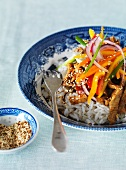 Stir-fried pork with rice, sesame seeds and vegetables (Thailand)