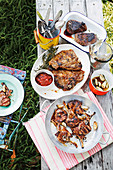 Grilled T-bone steaks, fillet steaks and lamb chops with garlic