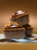 Chocolate Hazelnut Cupcake with Chocolate Frosting and Chopped Hazelnuts in a Striped Cupcake Liner