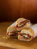 Tre panini al salame (sub sandwiches with salami)