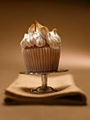 One Lemon Meringue Cupcake on a Small Pedestal Dish