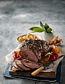 Leg of lamb with capers and chilli peppers for Easter