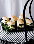 Mini bread rolls filled with scrambled egg and watercress