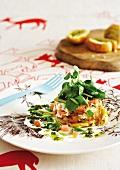 Smoked fish with potato rösti, basil pesto, crème fraîche and watercress