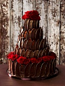 Five-tier truffle cake with roses for a wedding