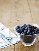 Fresh blueberries in a glass dish