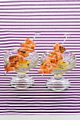 Prawn skewers with passion fruit and ginger dip
