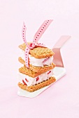 Ice cream sandwiches made with wafers and strawberry ice cream