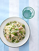 Spaghetti with salmon, asparagus and broad beans (view from above)