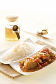 Meatballs with honey sauce and rice