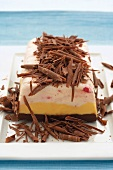 Three-colour ice cream layer cake with elaborate chocolate decoration