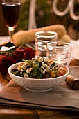 Bean salad with chickpeas, Parma ham and blue cheese
