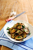 Fried Jerusalem artichoke slices with garlic and parsley