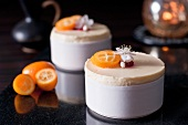 Creamy passion fruit and raspberry mousse with kumquats