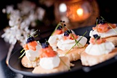 Mini blinis with cream cheese, smoked salmon and lumpfish caviar