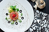 Smoked salmon tartar with cress, black olives and red pepper