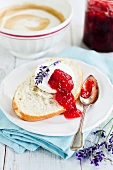 Bread topped with goat's cheese and strawberry jam