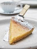 Slice of lemon tart on plate