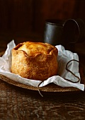 Close up of pork pie on wooden board