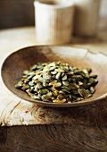 Wooden bowl of pumpkin seeds