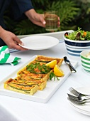 Asparagus and salmon tart on a garden table