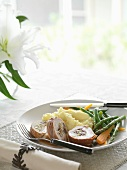 Chicken roulade with pistachios, mashed potatoes and vegetables