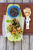 Grilled vegetable kebabs with sesame seeds and chilli tofu (Asia)